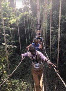 UB MBA students make their way across the 130-foot suspension bridges above the Kakum Rainforest, Ghana