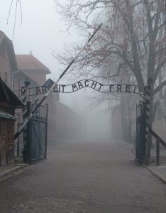 """Entrance to Auschwitz Concentration Camp with the famous """"Arbeit Macht Frei"""" (Work makes you free) sign."""