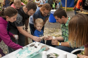 A GRoW Home member interacting with members of the public at Fall Festival at Reinstein Woods