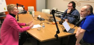 Photo of Norma Nowak talking with Nate Benson and Darren Treadway in the studio