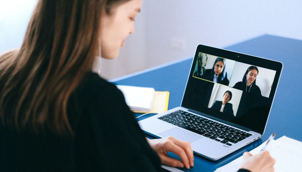Woman leader videoconferences with her team.