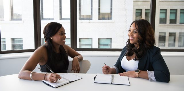 Two women have a business meeting.
