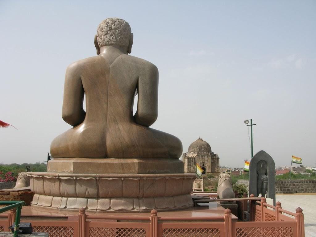 Jain murti overlooking Muslim tomb in Mehrauli, Delhi